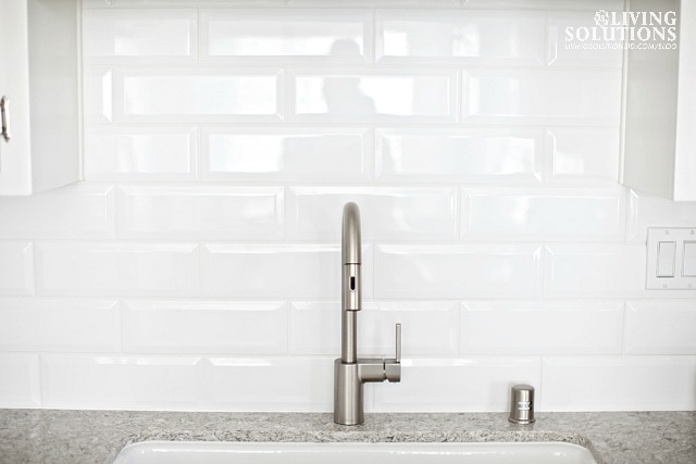 *white beveled subway tile Moen Align kitchen faucet
