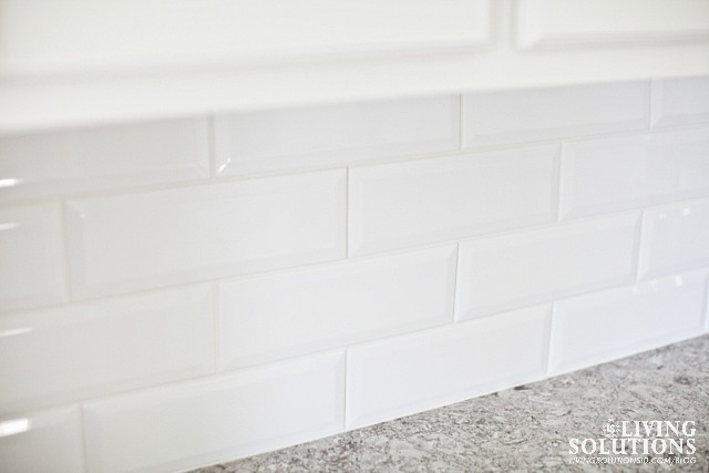 white beveled subway tile*