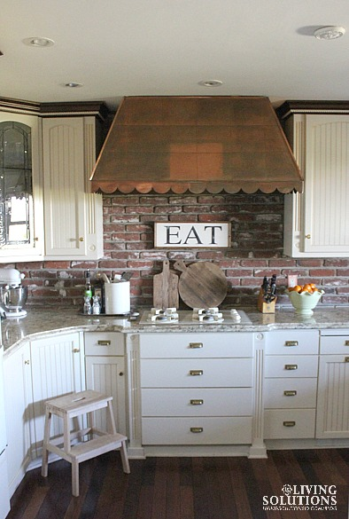 White Kitchen and Copper Hood