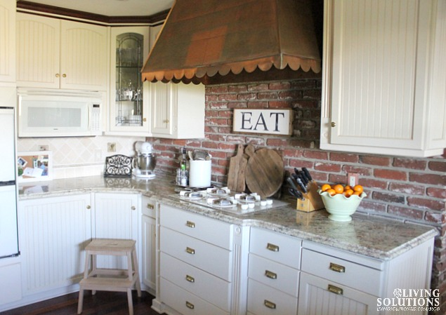white kitchen-copper hood-granite counters