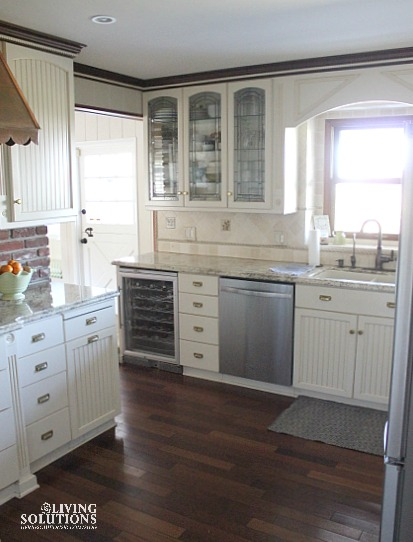 white kitchen-glass cabinets-stainless steel appliances