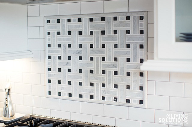 Carerra Marble and black baclsplash with subway tile